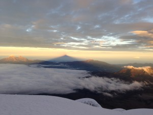 Sunrise on the Avenue of the Volcanoes: (from left to right) Iliniza Sur, Ilinza Norte, and Corazon from the Northwest flank of Vulcan Cotopaxi (19,347') Ecuador, December 25, 2012. Photo courtesy of Jason Kolaczkowski.