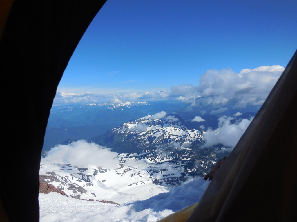 The view from just below Camp Hazard on the rock rib between the Wilson and Kautz Glaciers on Mount Rainier (14,410'). June 18th, 2013.