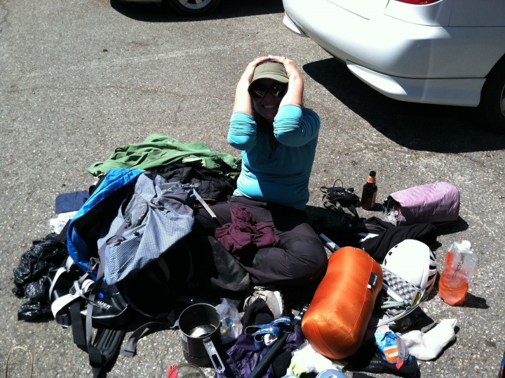 My wife, Kristina, repacking gear from pack to duffel in the parking lot of Mount Rainier (14,410'). July, 2012.